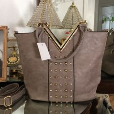 | New | Gorgeous gray Crystal handbag Brand new gorgeous Crystal handbag, gold tone hardware. Inside and outside zipper pockets, with shoulder strap. Very roomy, perfect for all essentials and more. BUNDLE & SAVE 25% ❌ TRADES ❌ Bags Shoulder Bags