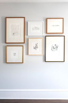When designing a grid gallery wall we use prints and photos with a similar theme. This could be black and white photos, botanicals, sketches, etc. Or we completely go with different pieces for an eclectic look. We usually hang large and medium pieces 2-3 inches apart, and smaller pieces 1.5-2.5 inches apart.