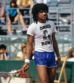 Yannick Noah in a Bowie tee shirt at practice. No such thing as official practice gear in those days.