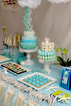 mermaid theme party. I am beyond in love with those cakes. The ruffles, the macarons, the 'pearl' truffles. SO BEAUTIFUL.