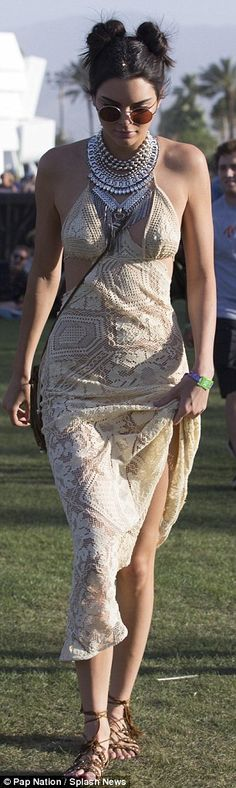 Leggy look: Kendall Jenner showcased her 5ft10 model figure in a white lacy maxi-dress at the Coachella Valley Music and Arts Festival in Indio on Friday