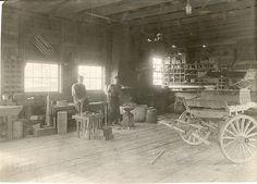 Two men in a blacksmith shop, circa 1929