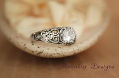 Sterling Silver White Sapphire Filigree Engagement Ring - Choose Your Stone - Unique Engagement Ring.  This lovely ring has two hearts bracketing the stone, symbolizing your two hearts joined together!  Repin this romantic ring to your own inspiration board!