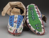 A PAIR OF SIOUX BEADED HIDE CEREMONIAL MOCCASINS c. 1890