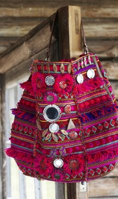 Java bag, richly coloured textile bag decorated with wooden beads, mirrors and fringing