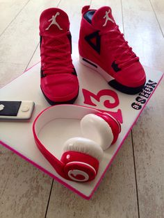 Nike air Jordan cakes with hand made dr Dre beat headphones and iPhone from icing