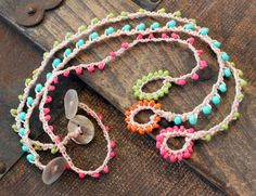 Surf's up! Crocheted Anklets/Bracelets (set of 3). Perfect for summer! Love the color contrast between the beads and the loop.