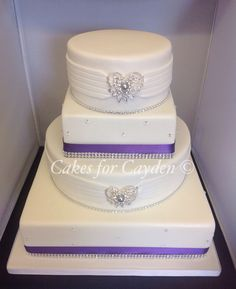 4 tier round and square wedding cake, purple and bling decor