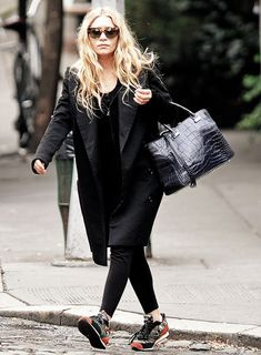 Ashley in all black, sneakers, croc bag.