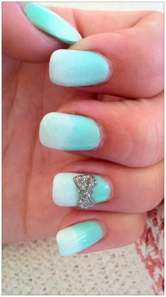 Mint to white ombre gel nails. 3D acrylic bow