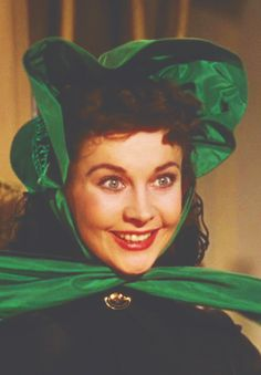 """Vivien Leigh as Scarlett O'Hara Hamilton in 'Gone With The Wind'. Scarlett: """"How do I look? Rhett: Awful. Just Awful. Why, what's the matter? This war has stopped being a joke...when a girl like you doesn't know how to wear the latest fashion."""""""