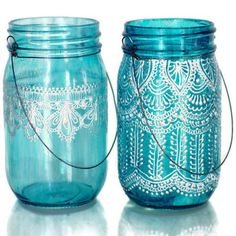Hand Painted Mason Jar Lantern with Peacock Blue Glass by LITdecor, $24.00 How lovely are these, it takes a steady hand to decorate the jars so beautifully gorgeous garden decorations for any summer party.