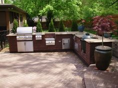 Backyard Design Ideas for Outdoor Kitchens, Decks, Sunrooms