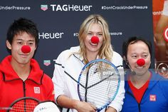 Japanese tennis player Kei Nishikori, Russian tennis player Maria Sharapova and former American tennis player Michael Chang pose with a red nose to support the Association Theodora fund event organized by Tag Heuer on May 18, 2015 in Paris, France.