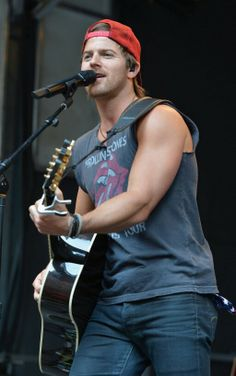 Kip Moore...those biceps are absolutely heavenly  love a real country men
