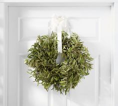 Grown in California and assembled by hand, the Fresh Olive Wreath has a fresh artisanal style. It's a welcoming accent in any room of the home and also makes an ideal seasonal gift. Pottery Barn, Front Door Accessories, Moss Wreath, Grapevine Wreath, Fresh Wreath, Olive Wreath, Faux Flower Arrangements, Floral Arrangement, Seashell Wreath