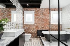 Exposed Brick Wall Modern Bungalow Style is part of home Style Exposed Brick - An exciting way of designing around an exposed brick wall Home decor ideas from a fantastic little Arizona bungalow from Knob Modern Design Brick Tiles Bathroom, Bathroom Red, Dream Bathrooms, Wall Tiles, Bathroom Ideas, Bungalow Bathroom, Bathroom Designs, Bathroom Wall, Modern Bathroom