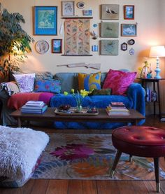 This room is full of happiness with colour, memories and pure warm happy thoughts. I love the blue sofa, a cool and classic addition to the bohemian style.