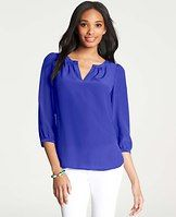 Split Neck Silk Blouse - Flaunting wear-now hues in luxurious silk, this infinitely wearable blouse boasts gorgeous sheen and a shirred split neck for a have-to-have look. Shirred split neck. Shirred 3/4 sleeves with button closure. Shirttail hem.