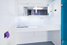 Integral Corian® Vanity with built in grab bars
