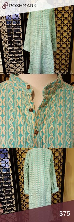 VINTAGE EMBROIDERED  TURQUOISE CREAM CAFTAN STUNNING!! Excellent vintage condition. No flaws. Size XXL. Mandarin collar. 4 gold button front. This caftan has pockets and 18 inch side slits. Bust is 46 inches. Length of sleeve from the top of the shoulders is 30 inches. Total length is 48 inches. I would wear this around the house and also as resort wear!! Belt it. Feels like cotton poly blend. Vintage Intimates & Sleepwear