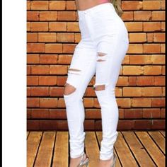 High waisted white jeans Medium stretchy material like jeggins ripped brand new fit true to size Jeans Skinny