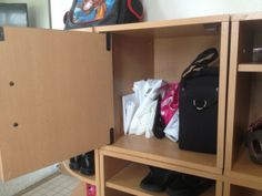 Use your home entrance hidden storage wisely for extras that you don't want everyone to see. Consider this area for plastic bags & travel extras. More great home organization tips on this site.