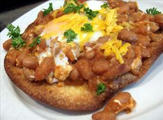 Huevos Rancheros Tostados from Food.com:   This lovely recipe, from Cooking Light, is great served with a fruit salad. Good for breakfast or dinner!