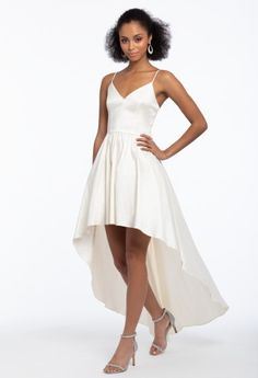 This party dress is perfect for an outdoor or indoor wedding reception! With its sweetheart neckline, fitted bodice, taffeta high-low flare skirt and open back with adjustable straps, you'll be sure to shine in this summery staple. Add some delicate details with T-strap sandals, stone earrings and a glitter metal handbag. #CamilleLaVie