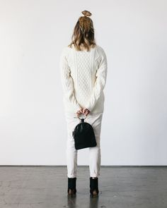 Large Ring Pouch in Black -- a buttery soft, leather zip pouch that's a minimalist dream from design collaboration, Otaat x Myers Collective (styled here with our Fisherman Sweater) www.fuggiamo.com #shopfuggiamo #knits #knitwear #minimal #white #topknot