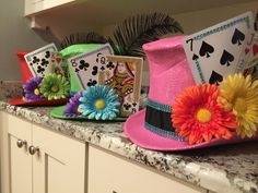 Mad Hatter Centerpieces.... The final look. This is three of the ten and I don't think any two are the same color! Since I wanted a sense of unity with the ten, I decorated the different colors the same. Cute right?
