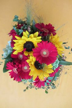 Red gerbera daisies and sunflower bouquet