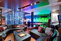Modern Game Room with Refurbished pinball machine, American Heritage Billiards Britton Rack, flush light, Hardwood floors