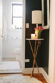 @Danielle Moss Chicago Home Tour // hallway // dark paint // Lulu & Georgia table and lamp // photography by Stoffer Photography
