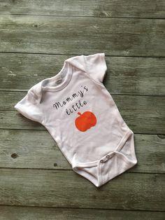 A personal favorite from my Etsy shop https://www.etsy.com/listing/463073204/mommys-little-pumpkin-bodysuit-pumpkin