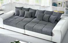 La struttura del divano Speedway, è caratterizzato da cuscini ...