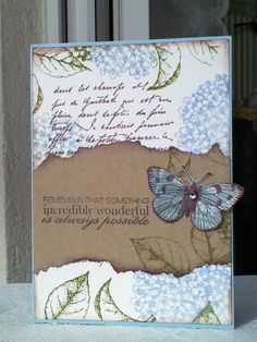 Love the collage of various stamp images along with the torn kraft panel highlighting the butterfly - a nice LO