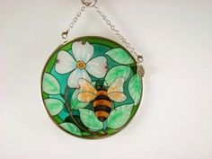 Amia Hand Painted Glass Suncatcher with Bee Design, 3-1/2-Inch Circle by Amia. $10.00. Handpainted glass. Comes boxed, makes for a great gift. Includes chain. Amia glass is a top selling line of handpainted glass decor. Known for tying in rich colors and excellent designs, Amia has a full line of handpainted glass pieces to satisfy your decor needs. Items in the line range from suncatchers, window decor panels, vases, votives and much more.