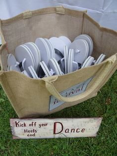 "Where better to provide flip flop alternative to wedding guests than for a lakeside beach summer wedding in Maine?  ""Kick off your heels & Dance"" sign painted on wood by Kate Crane"