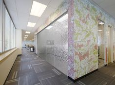 Custom graphics were designed for the wall covering and distractor graphics in the space that depicted topography maps - a key tool in ERM's business.