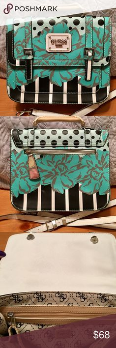 """🖤 Guess 🖤 🎉HP🎉 ✨🖤Limited Edition🖤✨🔆💼 Beautiful Black and Teal 🔆 Satchel Crossbody or Shoulder Bag 💼🔆 Double magnetic front flap closure 🔆 Front slip pocket perfect size for smartphones 🔆 1 large zipper and 3 slip pockets inside 🔆 detachable strap 48"""" too 55"""" including hardware 🔆 camel leather hand strap approx 8"""" including hardware 🔆 all hardware in excellent condition 🔆 no rips or stains 🔆 1 small scuff mark on back {see last pic} 🔆 sorry no trades 🔆 🤠 Make me an…"""