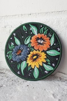 "3.5"" embroidered patch with merrowed border and iron-on backing. Follow the instructions below to affix this patch to a garment of your choosing (click to enlarge)! For items that will be washed, sewing on is recommended."