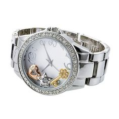 """Fabulous ladies link watch with silvertone case, rhinestone bezel, and dial with floating charms: a key, a heart, and a star.· Face: 1 5/8"""" diameter· Band: 6 3/4"""" L x 3/4"""" W with Foldover clasp· Extender: 2 3/4"""" L· Battery: Replaceable SR626SW· Movement: Quartz- PC21J· ImportedPaula Abdul is an award-winning, singer-songwriter, dancer, choreographer and television personality.get yours now at youravon.com/dondokat"""