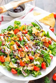 BBQ Chicken Salad recipe — this healthy salad is so quick and easy to make! With juicy BBQ grilled chicken, crunchy tortilla chips, and creamy ranch dressing, it's filling and a family favorite. @wellplated