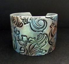 Silver Cuff Bracelet Polymer Clay Jewelry Hand Stamped Jewelry Asian Inspired Flower Bracelet. $18.00, via Etsy.
