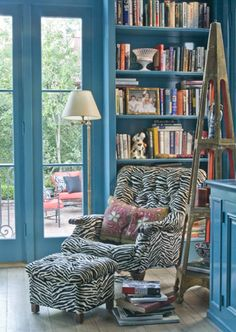 An étagère found by the client in a Magazine Street antique shop sits next to a mod zebra upholstered chair with vintage pillow- Melissa Rufty of MMR Interiors Southern Comfort, Southern Style, Chair And Ottoman, Upholstered Chairs, Tufted Chair, Zebra Chair, Leopard Chair, Home Libraries, Chinoiserie Chic