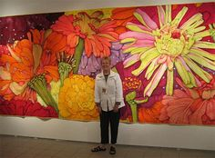 this is impressive: Velda Newman standing in front of her quilt, Zinnia. You've seen them small in books... always look at the measurements in the fine print. Some of them fill a wall!