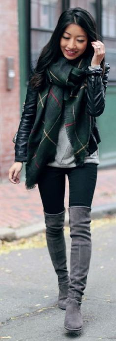 Jean Wang wears grey over the knee boots with an authentic tartan scarf and a leather jacket. Scarf: Sole Society, Tee: Loft, Jacket: BlankNYC, Jeans: J Brand, Boots: Stuart Weizman.