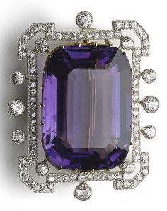 An Edwardian amethyst and diamond brooch, circa 1910. Set to the centre with a…