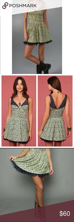 FREE PEOPLE  Mini Floral Fit & Flare Dress FREE PEOPLE's  'Dazzling Ditsy' floral print dress features a lacy crochet trim, deep V lines, bra-friendly straps, a flared skirt & tulle-hem underskirt that peeks out.  Size: SMALL (2-4) Color: NAVY COMBO  - Cotton Sateen fabrication - A-line silhouette - Sleeveless - Sheer crochet lace trim - V neck + back - Button-&-loop front placket - Banded empire waist - Smocked back - Fully lined - Hidden side zip  CONTENT + CARE:  Cotton. (+ Nylon…